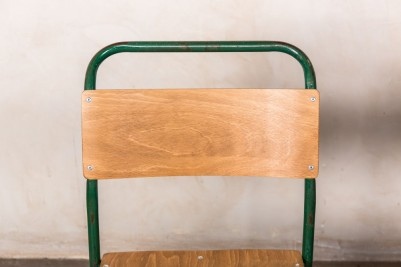 green frame stacking chairs