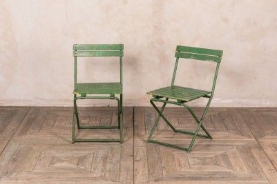 green slatted chairs