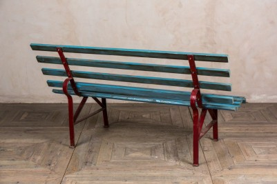 large blue railway bench