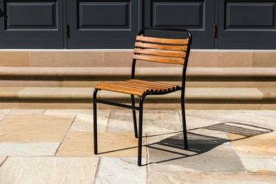 black slatted stacking chair