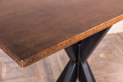 pedestal base table with large copper top