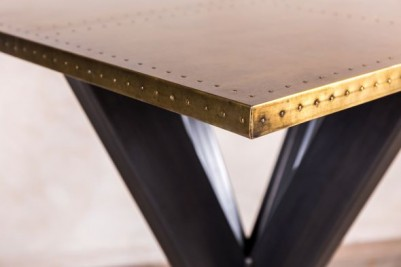 tank trap table with brass top