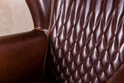 stitched leather armchair