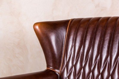 winged leather armchair