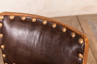 brown studded dining chair
