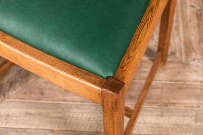 green upholstered restaurant dining chair