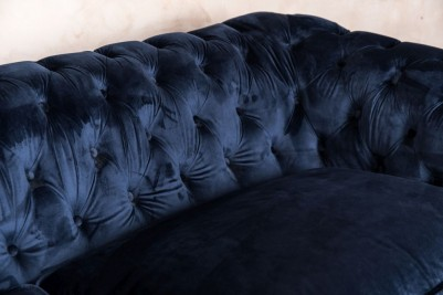 velvet upholstered sofa