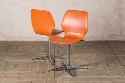 orange 1960s dining chairs