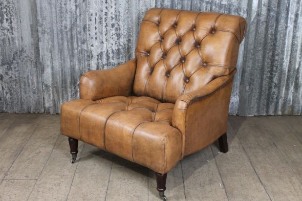 buttoned leather armchair