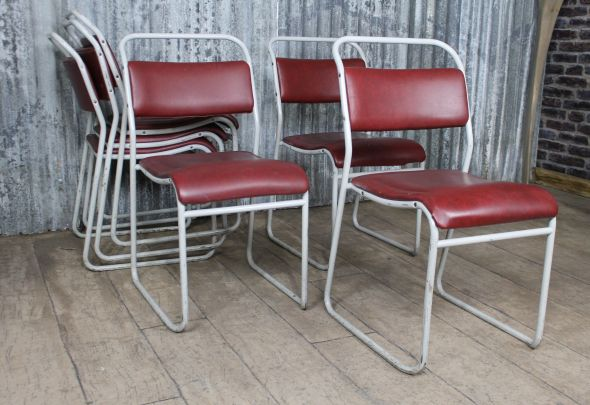 red padded white frame stacking chairs