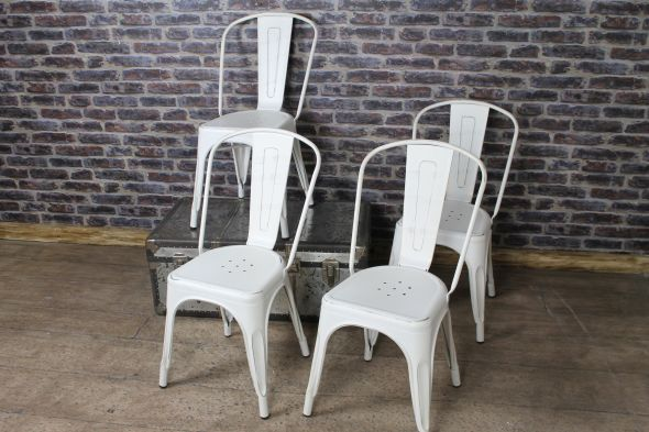 aged white Tolix chairs